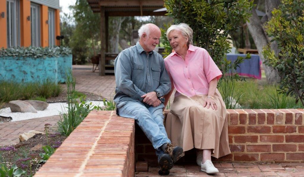 Colin and Maggie Beer, on the bench between the original Farmshop and daughter Elli's Eatery on reopening after COVID lockdown reminiscing about their journey. featured image